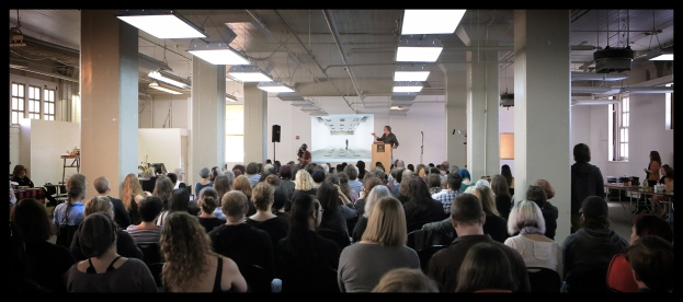 Artist David Orr speaking at Death Salon: San Francisco. Photo by Annetta Black